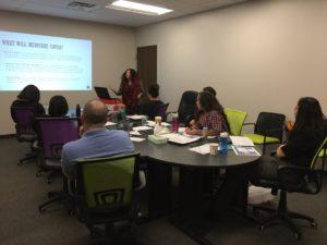 Legal advocate Marina Kurakin training 2017 summer interns about Medicaid