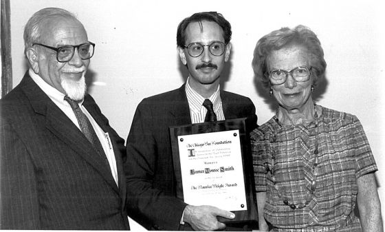 Founder James Monroe Smith (center) with Maurice Weigle, Jr. and his wife Helen Weigle, presenting Smith with the Weigle Award in 1989 at the Chicago Bar Association annual luncheon.